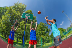 Fisheye view of children jumping for flying ball Royalty Free Stock Image