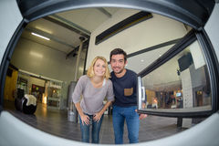 Fisheye view couple from inside woodburner. Fisheye view of couple from inside a woodburner Royalty Free Stock Image