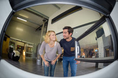 Fisheye view couple looking at woodburner. Fisheye view of couple looking at woodburner Stock Photography