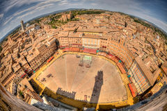 Fisheye view of Il Campo. Fisheye view of Piazza del Campo as it is set up for il Palio, a traditional horse race in Siena, a city in Italys central Tuscany Stock Photos