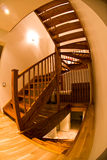 Fisheye View - Interior Stairs. Fisheye lens view of an interior wooden stairway with some distortion royalty free stock photography