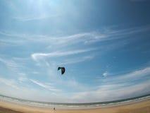 Fisheye view of kiteboarder on beach royalty free stock photos