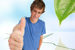 Fisheye view of a male student the thumbup. Composite image of fisheye view of a male student the thumbup Stock Photography