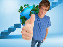 Fisheye view of a male student the thumbup Royalty Free Stock Photo