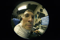 Fisheye view of man working Royalty Free Stock Images