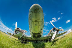 Fisheye view of the remains DC3 aircraft. Fisheye view of the remains of an abandoned Dakota DC3 aircraft from World War II on an airfield near Otocac, Croatia Stock Photography