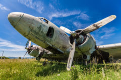 Fisheye view of the remains DC3 aircraft. Fisheye view of the remains of an abandoned Dakota DC3 aircraft from World War II on an airfield near Otocac, Croatia Royalty Free Stock Photos
