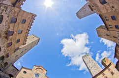 Fisheye view of San Gimignano towers and buidings on central square, Tuscany Royalty Free Stock Image
