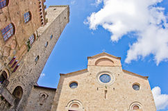 Fisheye view of San Gimignano towers and buidings on central square, Tuscany Stock Image