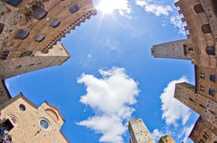 Fisheye view of San Gimignano towers and buidings on central square, Tuscany. Italy Stock Images