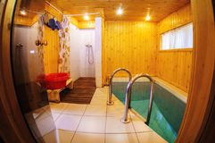 Fisheye view of a sauna - finnish hot treatment room Stock Photo
