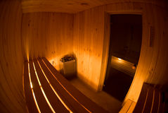 Fisheye View of Sauna Interior. A fisheye lens view of the interior of a Wooden Sauna Royalty Free Stock Photo