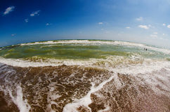 Fisheye view of sea waves in a sunny day Royalty Free Stock Photos