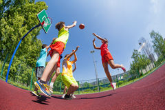 Fisheye view of teenagers playing basketball game. Together on the playground during sunny summer day stock photos
