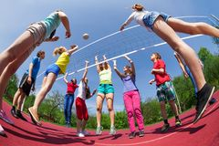 Fisheye view of teens playing volleyball outside Stock Image