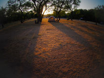 Fisheye View of a Tent at Sunset. A tent at a campsite at Enchanted Rock State Park outside of Austin, Texas. The sun sets behind the tent casting long shadows Stock Photography