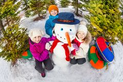 Fisheye view from top of children and snowman Royalty Free Stock Image