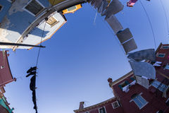 Fisheye View of Washings Drying in Colorful Burano, Venice Stock Image