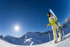 Fisheye view of woman holding ski with poles Royalty Free Stock Photos
