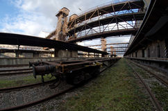 Fisheye wide view of a wagon in old abandoned industrial railway station in Prague Stock Photo