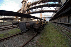 Fisheye wide view of a wagon in old abandoned industrial railway station in Prague Royalty Free Stock Image