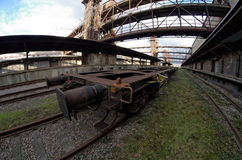 Fisheye wide view of a wagon in old abandoned industrial railway station in Prague Stock Images