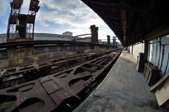 Fisheye wide view of wagons and constructions in old abandoned industrial railway station in Prague Royalty Free Stock Photos