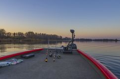 Fishfinder, echolot, fishing sonar at the boat at lake. Fishfinder, echolot, fishing sonar at the boat with fishing tackles Stock Image