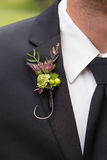 Fishhook Boutonniere. Groom`s boutonniere made from a large fish hook. Zoomed in on suit to show detail stock photo