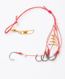 Fishhooks and feeder Royalty Free Stock Images