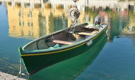 Fishig boat in Sirmione. Fishing boat moored in port of Sirmione on Garda lake in Italy Royalty Free Stock Photo