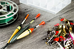 Fishig reel,iron baits and bobbers Royalty Free Stock Photos