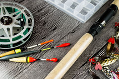 Fishig reel,iron baits.bobbers and spinning rod Royalty Free Stock Photos