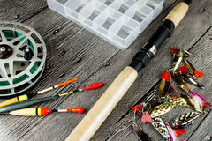 Fishig reel,iron baits.bobbers and spinning rod Stock Photos
