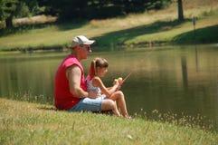 Fishin com minha menina Imagens de Stock Royalty Free
