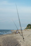 Fishing rods on sandy beach Royalty Free Stock Photos