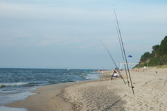 Fishing rods on sandy beach Royalty Free Stock Photography