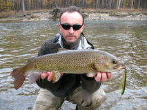Fishing. (Fisherman catched big trout Royalty Free Stock Images