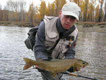 Fishing. (Fisherman catched big trout Stock Photo