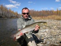Fishing. (Fisherman catched taimen fish in Mongolia Royalty Free Stock Photos