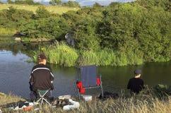 Fishing. Teenagers fishing on lake Stock Photos