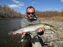 Fishing. (Fisherman catched taimen fish in Mongolia Royalty Free Stock Photography