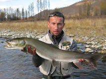 Fishing. (Fisherman catched taimen fish in Mongolia Stock Photos