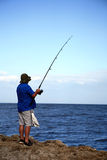Fishing. Patient Fisherman with the Rod royalty free stock photography