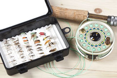 Fishing. Fly fishing rod and reel with a yellow popping bug stock image