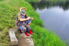 Fishing. Father learning his young son how to catch a fish Stock Images