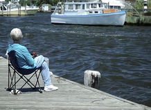Fishing. Photo of Person Fishing from Boardwalk Stock Photo
