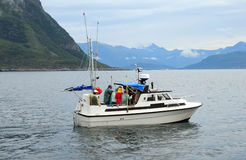 Fishing. Group of people fishing on a boat on one of the Norwegian fjords Royalty Free Stock Images