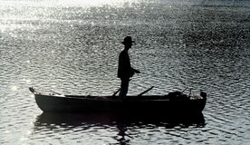 Fishing. Silhouette of man fishing at sunset Stock Photo