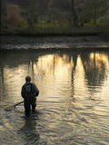 Fishing. Out of carps and halibuts in a farming pond, in sunset Czech village, Europe Royalty Free Stock Images
